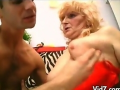 Aged granny in stockings and strap on fucks studs ass