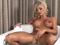 Charming porn diva Alicia Secrets with huge melons and shaved beaver fills the hole between her legs with dildo for webcam in solo action