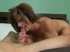 This perverted MILF with heavy juggs loves being screwed long and hard. After her pussy is tamed she gives her lover a satisfying oral-stimulation making him cum a huge load.