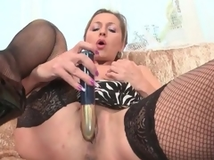 Lean mature playgirl in darksome fishnets masturbates