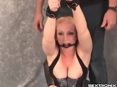 Bound and gagged milf in tight corset