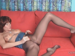 Sexy leggy MILF in sjeer black pantyhose