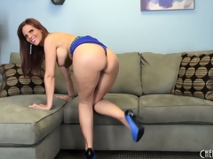 Sexy brunette MILF Syren De Mer loves to poses her hot bod on the ottoman
