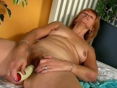 Lustful redhead granny Lady licking a giant vibrator with lust