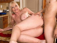 For her first on-camera fuck anywhere, 59-year-old Summeran Winters reenacts one of our favorite scenarios: MILF seduces the delivery boy. Now, if youve ever been a delivery boy, you know this kind of thing happens all the time. Real-life MILFs actually do seduce the delivery boy, whether its the pizza man or the supermarket guy.The thing is, though, usually, the delivery lad is on the receiving end of the most good blow job of his life. In rare instances, this guy gets some slit to fuck. But how often does this guy get to fuck the MILF in the ass? Almost never, which is what makes this scene so special. That and the fact that this guy gets to fuck Summeran in the wazoo on the kitchen table.In my personal life, I love anal sex, so why wouldnt I desire to have anal sex my first time in front of the camera, Summeran said. Some people make a large deal out of anal sex, but to me, whats the difference between me having a ramrod in my slit or a ramrod in my ass?By our estimate, a few inches, at most.
