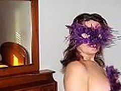 Chubby Spanish mature woman in cute bra with multicolor heart shaped patterns blows dong wearing a bizarre violet feather mask and listening to Santana's rendition of 'Black Magic Woman'.